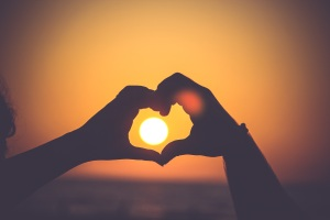 sunset heart hands